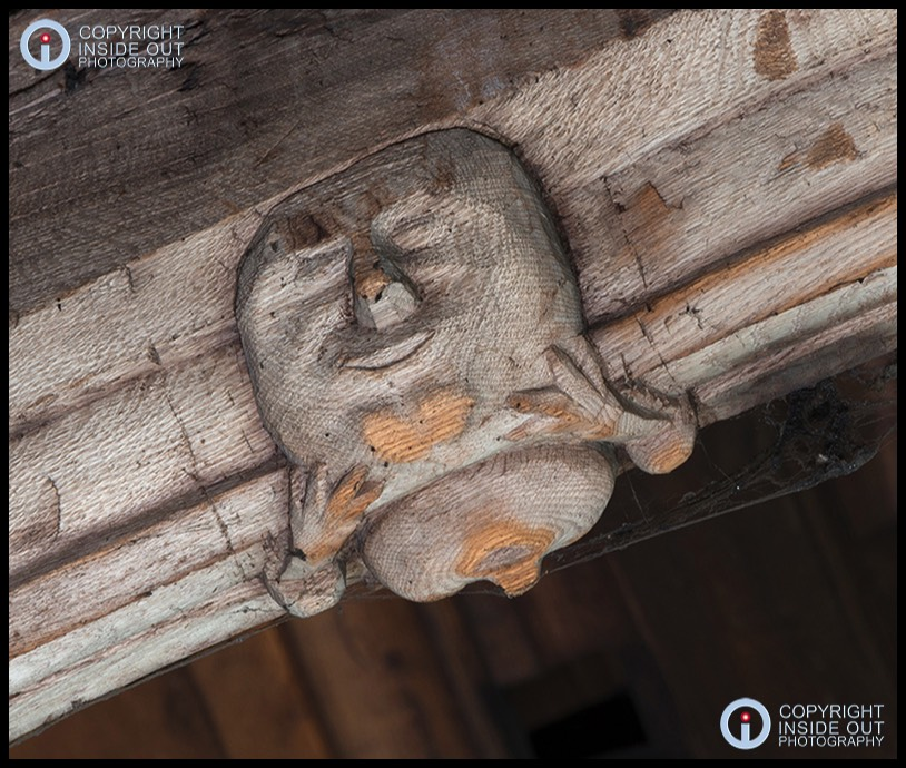 Medieval roof carving of humpty-dumpty type creature