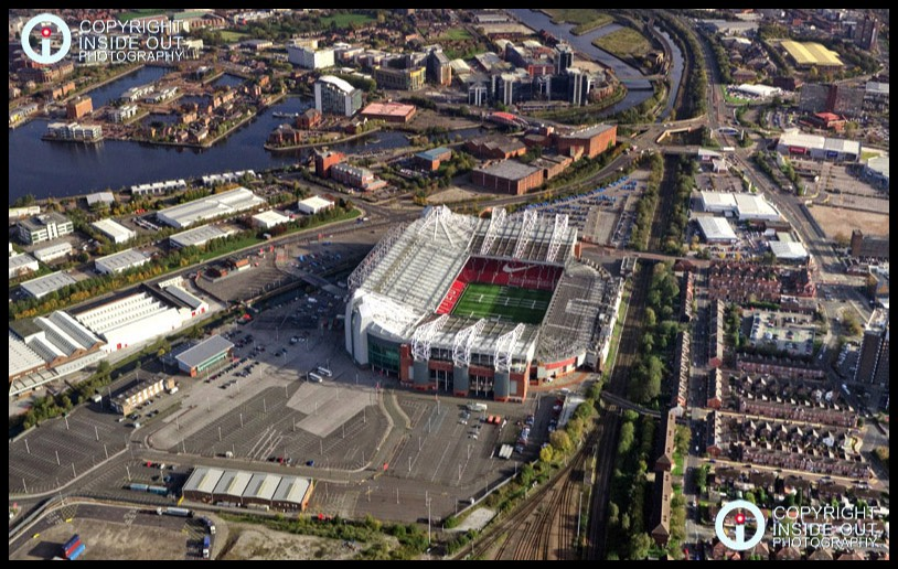 Wide aerial view of Manchester United FC and surrounding area - 2011
